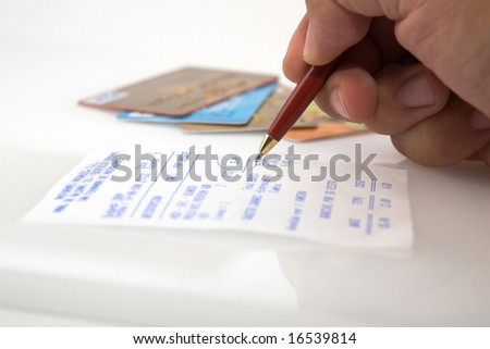 checking a receipt after buying - stock photo