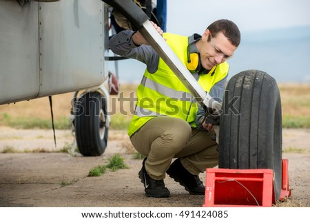 handsome young man electrician installing air stock photo