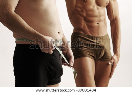 checking belly - stock photo