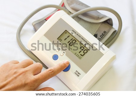 Checking blood pressure show normal blood pressure - stock photo