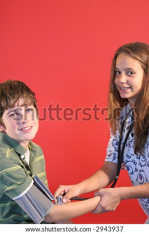 checking blood pressure vertical - stock photo