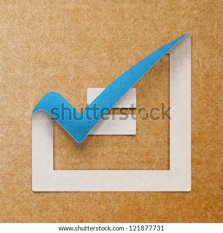 checking on checklist boxes made from recycled paper craft stick on background. - stock photo