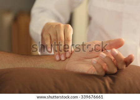 Checking pulse, close up - stock photo