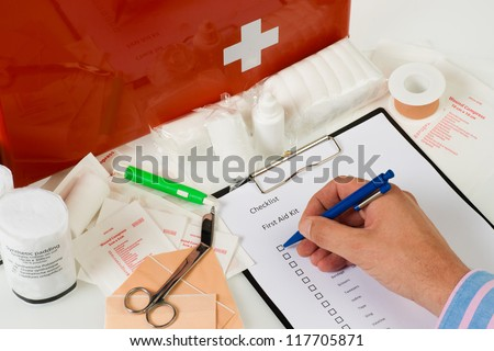 checking the content of a first aid kit - stock photo