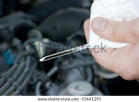 checking the engine oil - stock photo