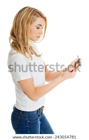 Checking the glucose level with a glucometer - stock photo