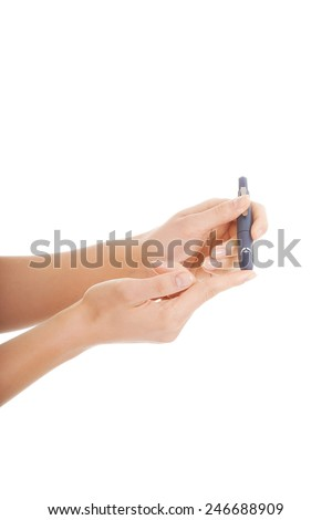 Checking the glucose level with a glucometer