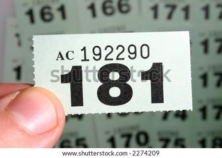 Checking the winning raffle ticket - stock photo