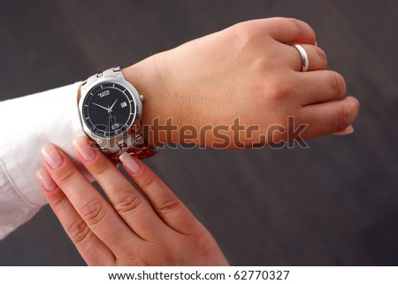 Checking time - stock photo