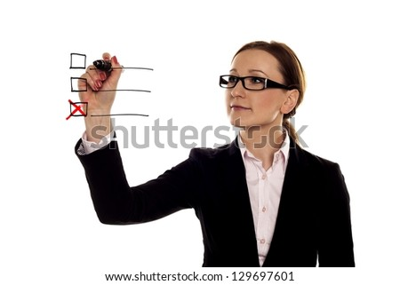 Checklist. A businesswoman making a red cross on a three point checklist.