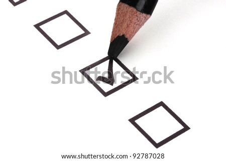 Checklist and black pencil closeup - stock photo