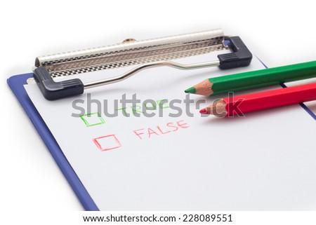 Checklist and Clipboard on white background,True or false checklist. - stock photo