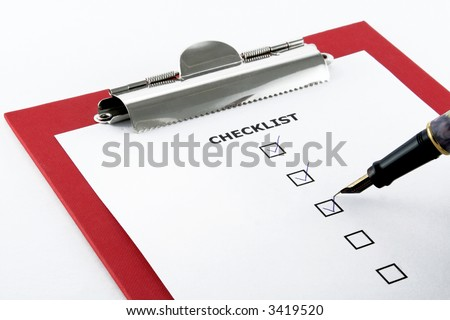 checklist and pen on clipboard, white background - stock photo
