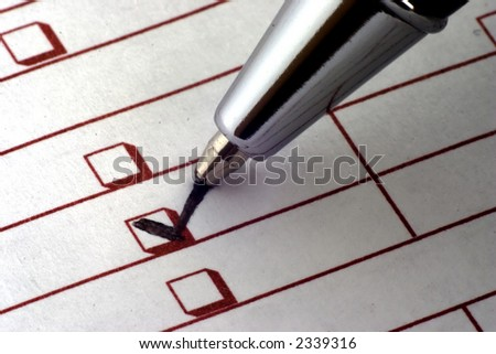 Checklist being filled out - stock photo