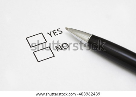 Checklist box with a pen and word YES and NO on white paper