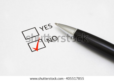 Checklist box with a pen and word YES and NO on white paper with a red checkmark