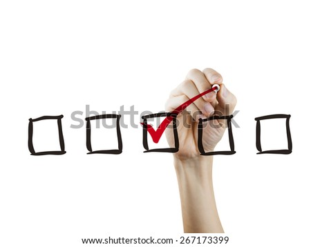 checklist checking by hand over white background - stock photo