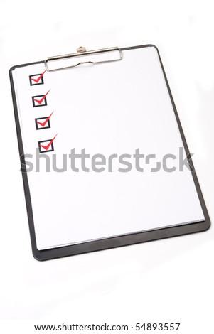 Checklist on clipboard - stock photo