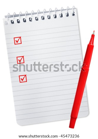 Checklist on spiral notepad, with red felt pen. - stock photo