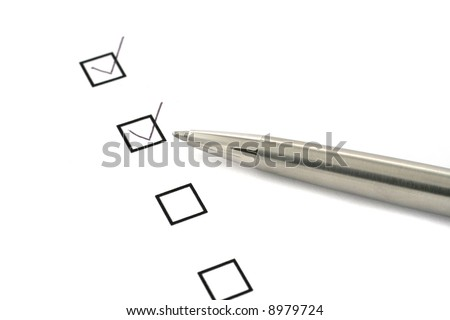 checklist on white paper and silver pen - stock photo
