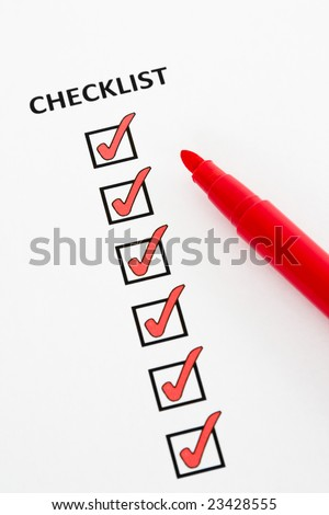 Checklist with checkboxes ticked using red pen