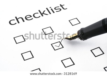 checklist with one box ticked and a pen - stock photo