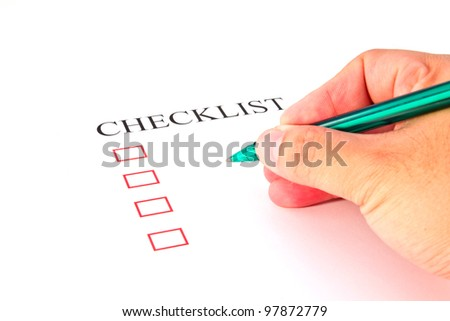 Checklist with pen and checked boxes.