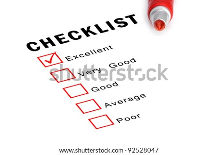 Checklist with red marker and checked boxes. - stock photo