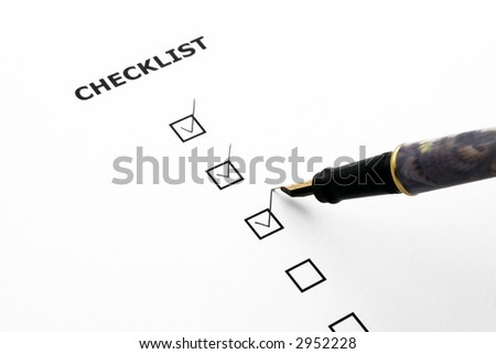 checklist with three boxes ticked and a pen - stock photo