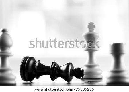 checkmate white defeats black king selective focus - stock photo