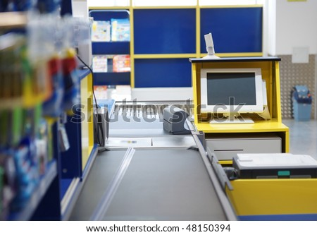 Checkout terminal in a supermarket - stock photo