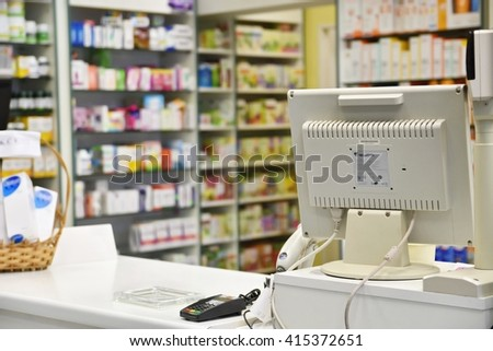 Checkout the pharmacy. Interior pharmacies and blurred background. Drugs and vitamins in pharmacies Boxes of medicines on the shelves. - stock photo