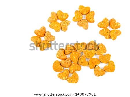 Cheddar dog treats arranged to form a paw shape. - stock photo