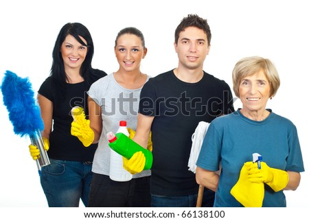 Cheeerful team of four people holding cleaning products isolated on white background