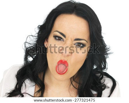 Cheeky Beautiful Young Hispanic Woman in Her Twenties Pulling Silly Faces and Sticking Out Her Tongue