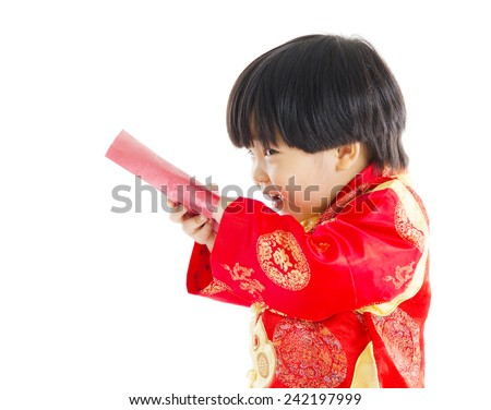 cheeky boy open up red packet. chinese new year concept. - stock photo