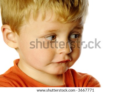 cheeky little boy on white - stock photo