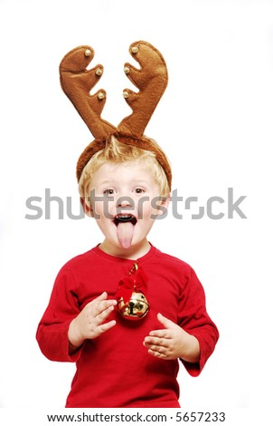Cheeky little boy with christmas antlers. - stock photo