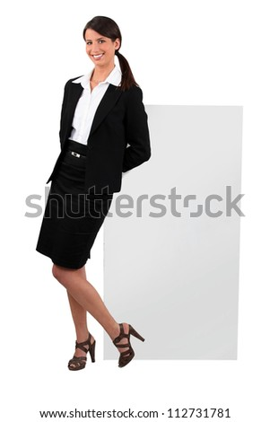 Cheeky woman in a skirt suit - stock photo