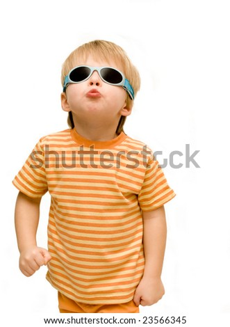 Cheeky 3 year old wearing sunglasses,looking tough. - stock photo