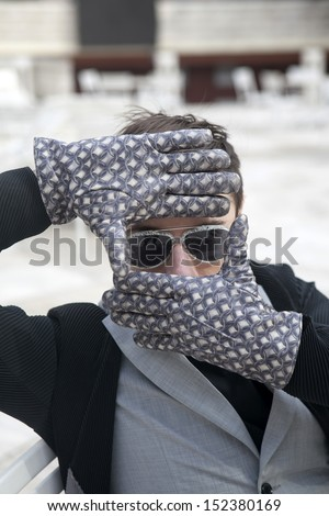 cheeky  young man in fashionable glasses - stock photo
