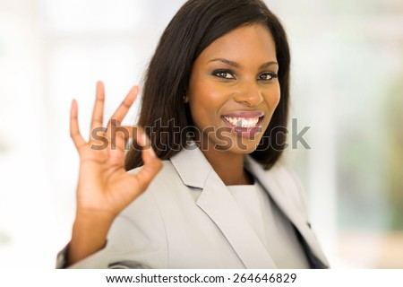 cheerful african american businesswoman giving ok hand sign - stock photo