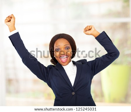 cheerful african american businesswoman in office - stock photo