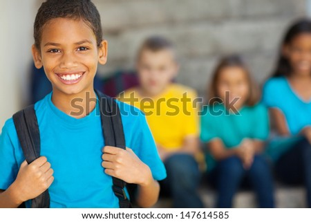 cheerful african american primary school boy with backpack - stock photo