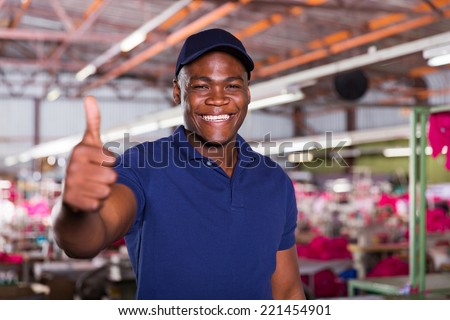 cheerful african american textile worker giving thumb up - stock photo