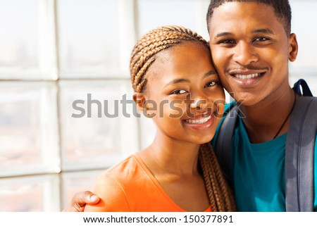 cheerful african american university couple on campus