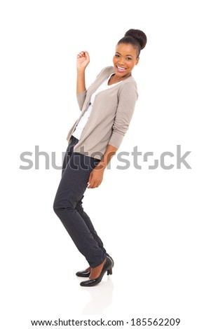 cheerful african american woman dancing isolated on white - stock photo