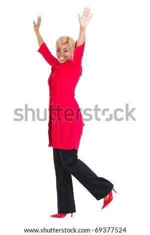 cheerful african american woman full length portrait in studio - stock photo