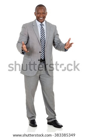 cheerful african businessman looking at the camera - stock photo