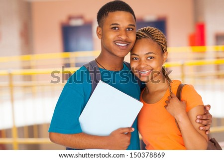 cheerful african college couple on campus